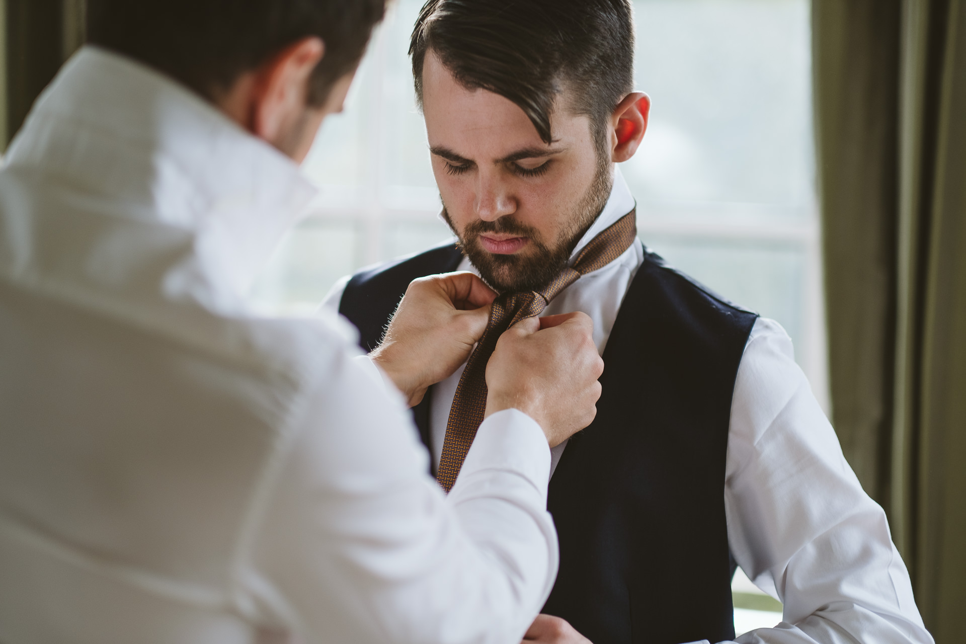 Why have a second shooter at a wedding? Capture groom prep!