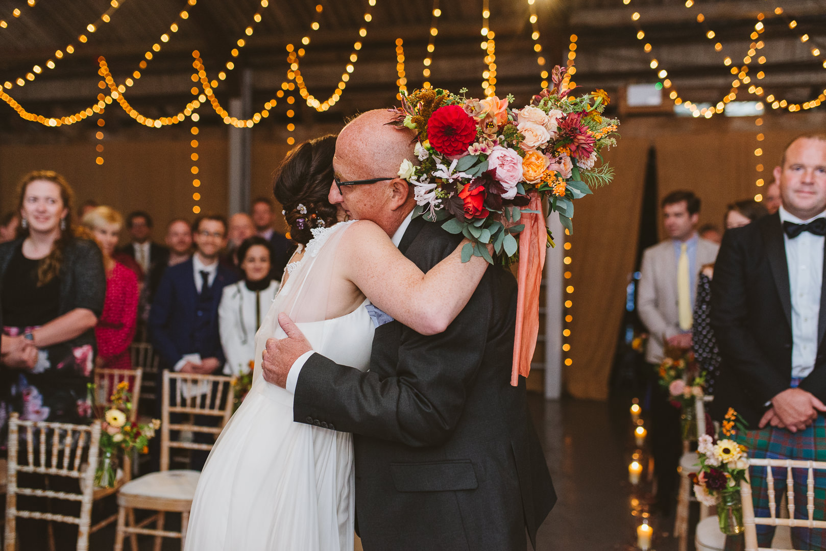 Beautiful photos of bride and dad hugging after walking down the aisle